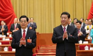 New president Xi Jinping (on the right) and former president Hu Jintao (on the left) at the closing meeting of the 12th National People's Congress